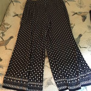 Navy ankle flowy pants with white polka dots